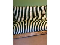 Futon - green and white striped, in good condition.