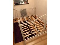Cream metal double bed - used but in good condition. (W) 145cm. (L) 198cm.