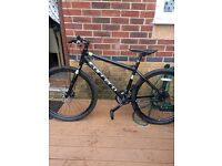 Men's carrera hybrid mountain bike for sale. Hardly used.