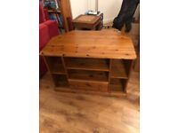 Corner TV Cabinet. Solid wood in good condition with 2 large shelves 4 smaller shelves and 1 draw