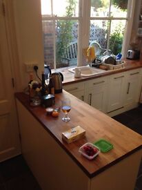 Kitchen units with oak top, including ceramic sink and taps