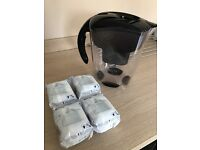 BRITA large digital water filter jug. AS NEW complete with 4 BRAND NEW cartridges