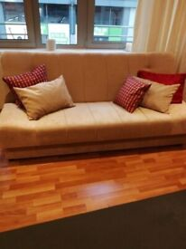 Cream, beige sofa bed with storage, used in perfect condition