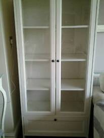 Ikea cabinet with glass doors, shelves and a drawer