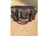 Small guess designer hand bag, excellent condition.