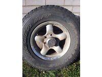 4 x jeep wheels with part worn Bridgestone tyres.
