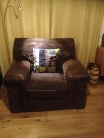 Large 3 seater, very comfy, chocolate brown couch, armchair and footstool.