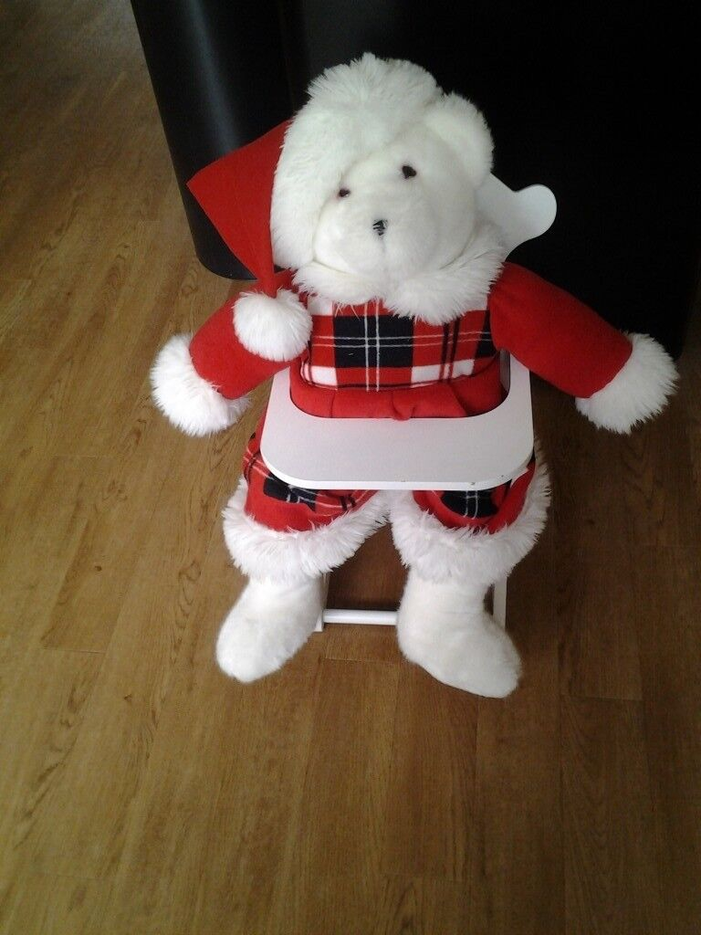 Cute white dolls high chair with mother Xmas cuddly toy.