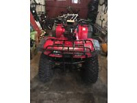 red Honda quad