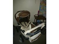 Babylux pram with carrycot Insert , flynet and bag included excellent condition