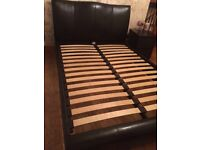 Black leather double bed frame.
