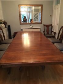 Extended dining table and 8 chairs including two carvers