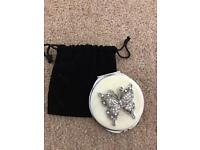 Compact mirror and pouch