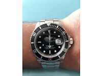 Rolex submariner 16610 boxed with papers
