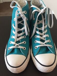 Turquoise Converse high-tops