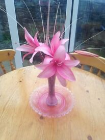 Bright pink fluted vase which includes silk flowers also a pink bowl no chips stands 10 inch.