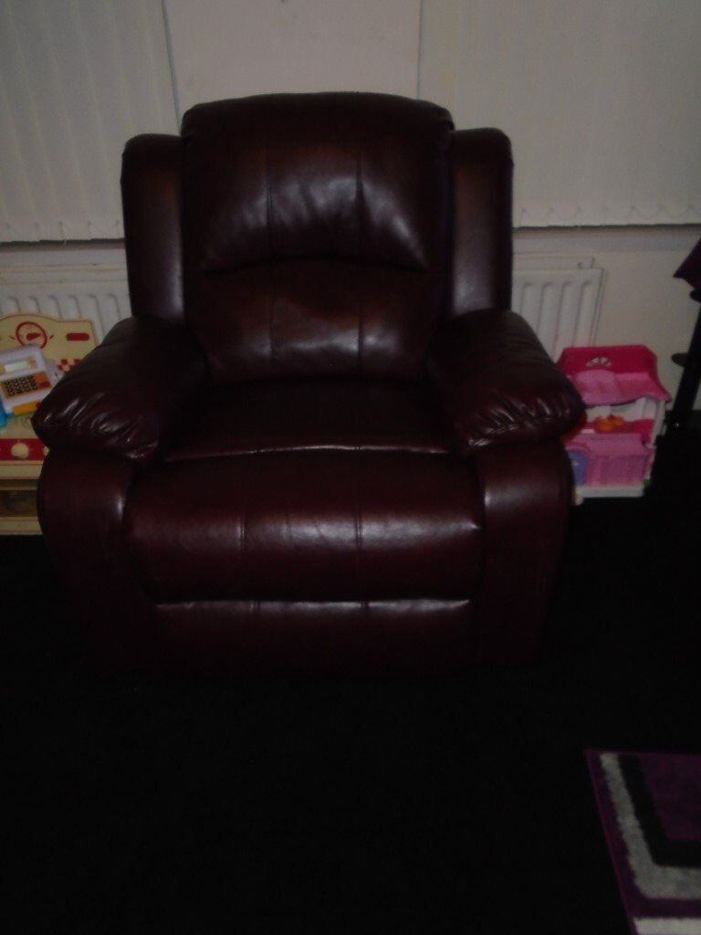 Leather sofa and two reclining chairs