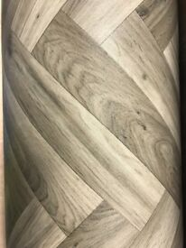Vinyl flooring grey herring bone effect