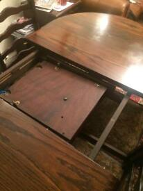 Dark oak oval table / extendable with 4 chairs