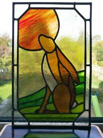Sun-gazing hare stained glass panel