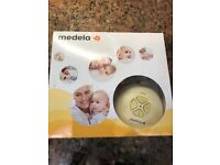 Complete Medela breast pump kit in original box,all instructions & 2 unused Boots baby bottles.