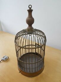 Antique bird cage in bronze