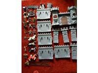 Knights castle with figures horse catapults weapons etc