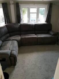 Large grey suede corner sofa