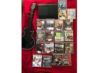 PS3 Super Slim 500gb with 19 games + guitar + 1 ps3 controller.