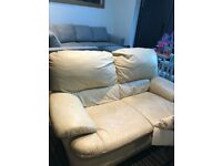 Two seater cream leather sofa for sale