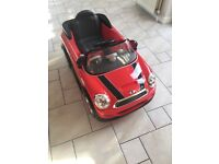 Red Mini Cooper ride on car - excellent condition