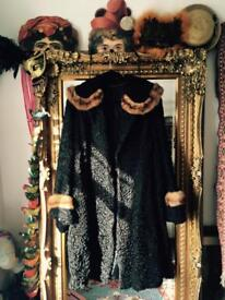 Beautiful black astrakhan and mink fur coat