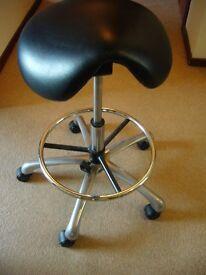 Black Premium Tilting Saddle Stool, adjustable height.