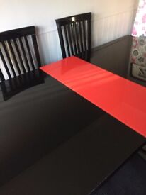 Dining table and 6 chairs DFS RRP £1600 Gloss black, Glass top.