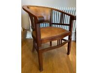 Ornate arm wooden chair with leather seat