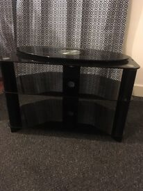 Black glass TV stand with turn table
