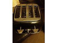 Delonghi black four slice toaster