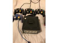 Black GameCube in good working condition with 4 controllers, 13 games, and 251 memory card