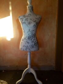 Mannequin. Cream floral fabric. Adjustable height. Good condition. Has box