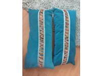 Pair of turquoise cushions