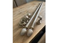Rustic gold curtain pole with support and rings