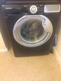 (Needs fixing)Black Hoover washing machine