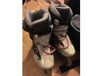 Ladies Size 4 Roller Blades with bag