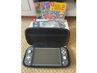 **price reduced** Nintendo Switch Lite + Case + 3 Games