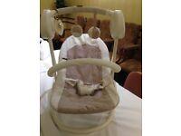 Mamas and Papas lullaby swing seat and matching play mat.