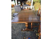 Extending Wooden Dinning Table and Four Chairs