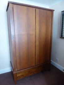 Double door dark brown wooden wardrobe, with large drawer