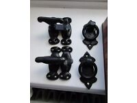2 (black iron) door latches and 20 matching door handles.