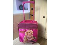 Disneystore Rapunzel pull along suitcase and groovy chick pull along suitcase. Will sell separately