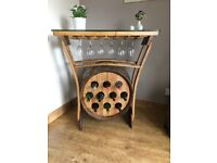 Lovely piece of furniture, wine rack made from a solid oak whisky barrel